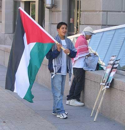 terrorist_sympathizer_with_palestinian_flag_sm.jpg